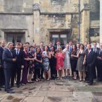Colour group photograph showing Beth Margaret Taylor with her fellow members of the Genesis Sixteen choral training programme together with Harry Christophers and the members of The Sixteen