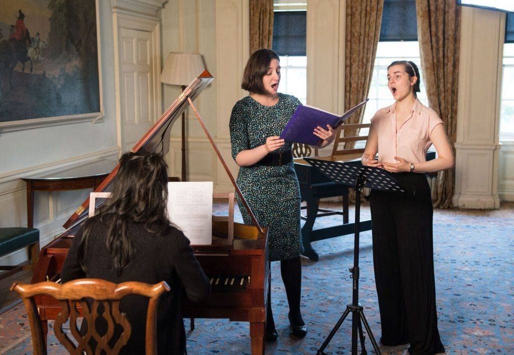 Colour photograph showing members of the Burns Period Performance Project, including Beth Margaret Taylor as mezzo-soprano, playing and singing during a recording of a Burns song, (Courtesy of AHRC-funded Editing Burns for the 21st Century research project)