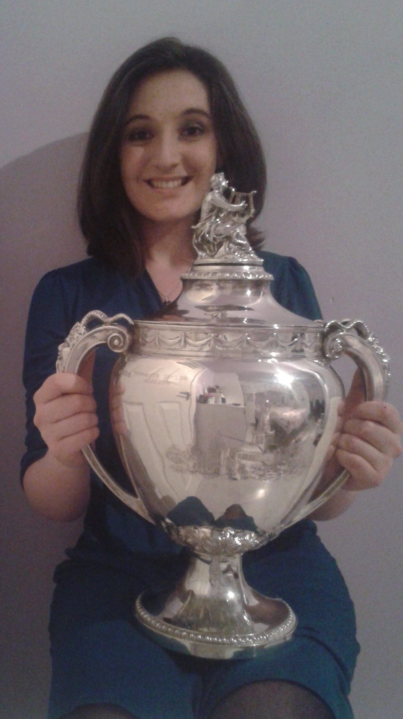 Colour photograph showing Beth Margaret Taylor with the trophy as winner of the Gervase Elwes Memorial Prize at the Glasgow Music Festival in 2014