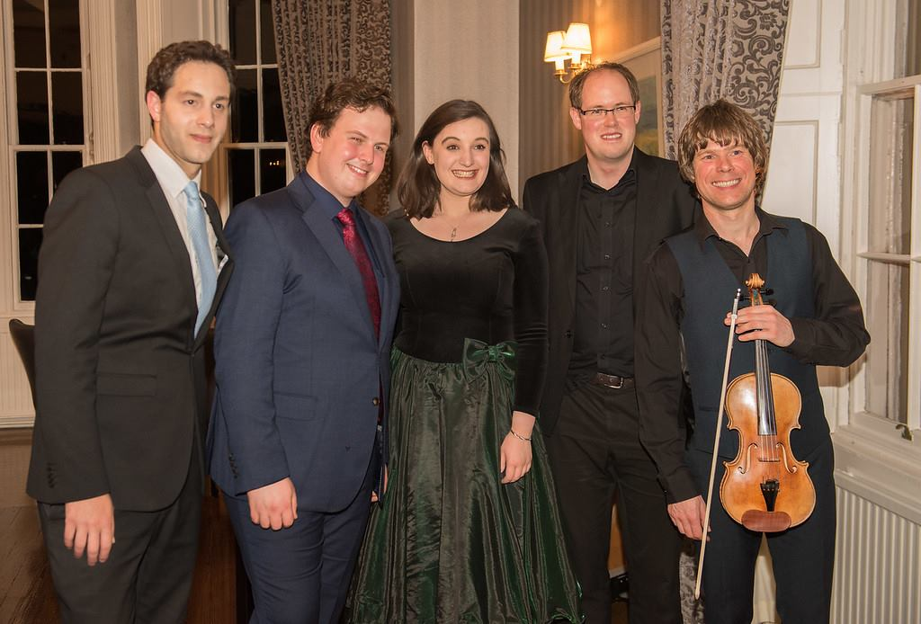 Colour photograph of the singers and musicians at a springfest recital