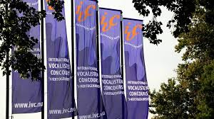 Colour photograph showing a row of banners outside a venue advertising the IVC 2018 's-Hertogenbosch