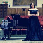Colour photograph shopwing Beth Margaret Taylor,mezzo soprano, on stage singing Rossini at the 2018 Concorso Internazionale Piemonte Opera
