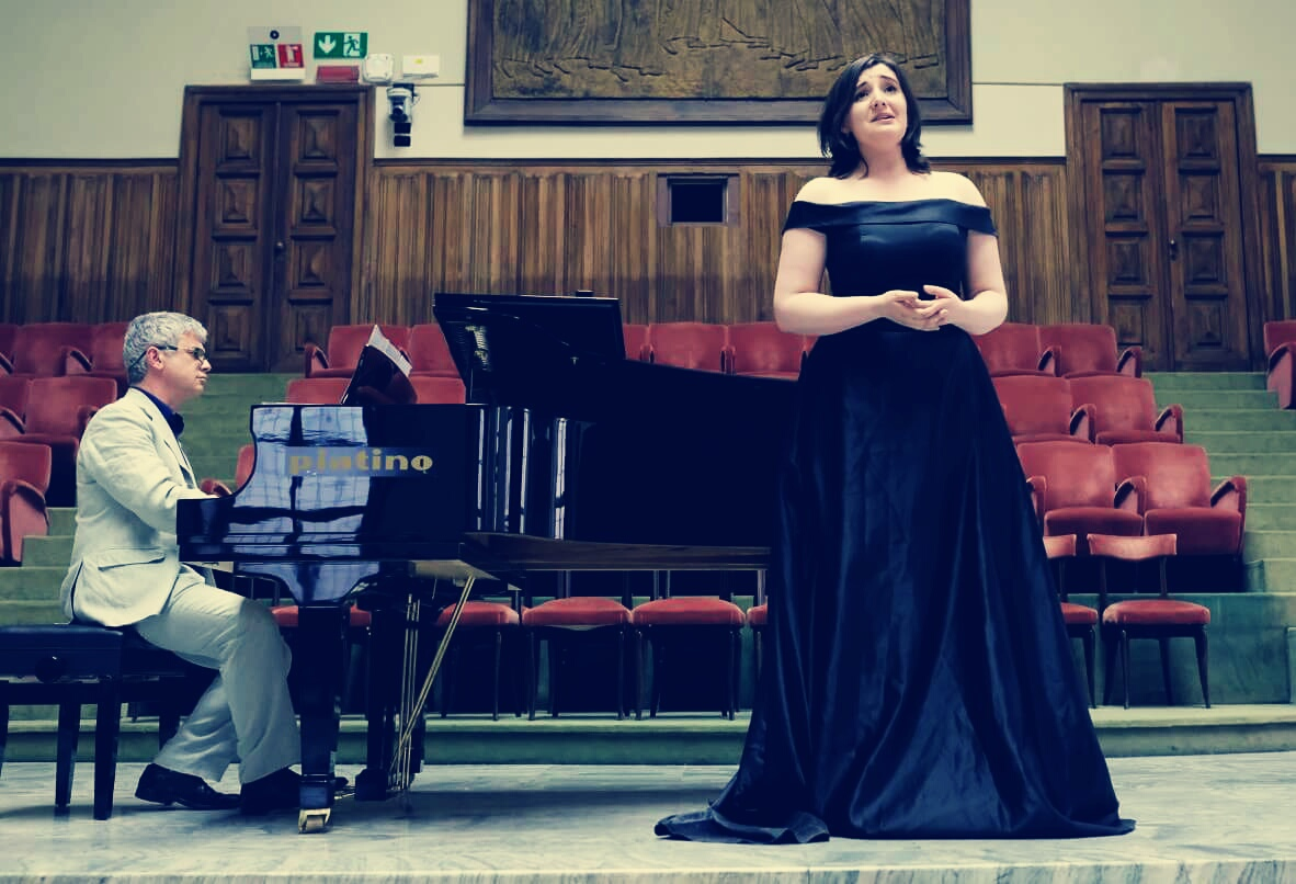 Colour photograph shopwing Beth Margaret Taylor,mezzo soprano, on stage singing Rossini at the 2018 Concorso Internazionale Piemonte Opera