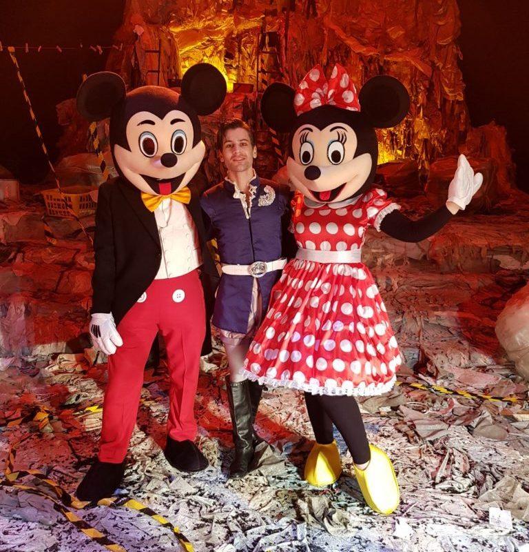 Colour photograph showing characters in costume, including Beth Taylor as Minnie Mouse, from an Opéra de Lyon production of Resphigi's La Belle au Bois Dormant