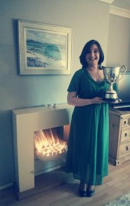 Colour photograph showing Beth Margaret Taylor, mezzo soprano, with the Carmichael Trophy for winning the Hugh S. Roberton Scottish Song Prize at RCS in 2017
